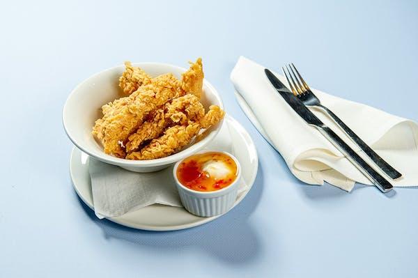 Paski z kurczaka w chrupiącej panierce z sosem C.K., 200g