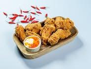 Pikantne skrzydełka z kurczaka w chrupiącej panierce z sosem C.K., 10szt