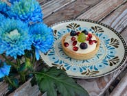 Tartaletka z białą czekoladą i malinami 8 Ø