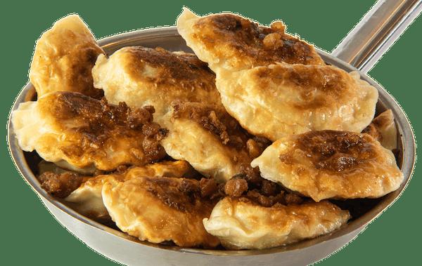 Pierogi z boczkiem wędzonym i ziemniakami    - podsmażane
