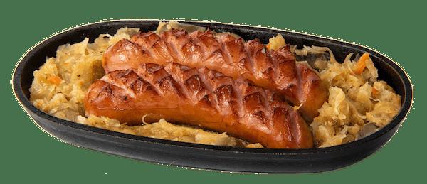 Kiełbasa śląska wieprzowa z dodatkiem wołowiny podana na duszonej cebuli