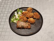 Mușchi de porc în crustă de ierburi aromate cu ciuperci sote