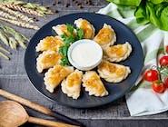 Pierogi z kurczakiem, grzybami i zasmażaną cebulką