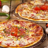Do każdej pizzy 2 sosy gratis!